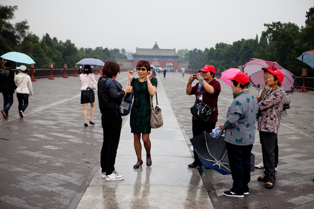"A group of tourists at ""The Temple of Heaven"" which is a complex of Taoist buildings situated in the southeastern part of central Beijing. Beijing is the capital of the People's Republic of China and one of the most populous cities in the world with a population of 19,612,368 as of 2010."