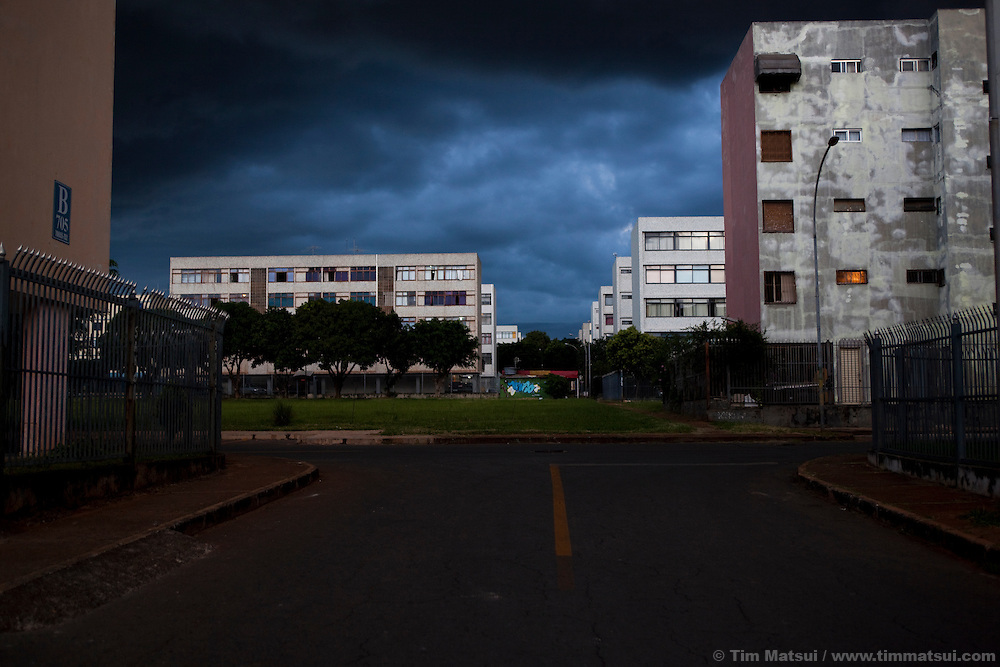"A neighborhood of apartment highrise block buildings, known as ""superblocks,"" in Brasilia, Brazil."