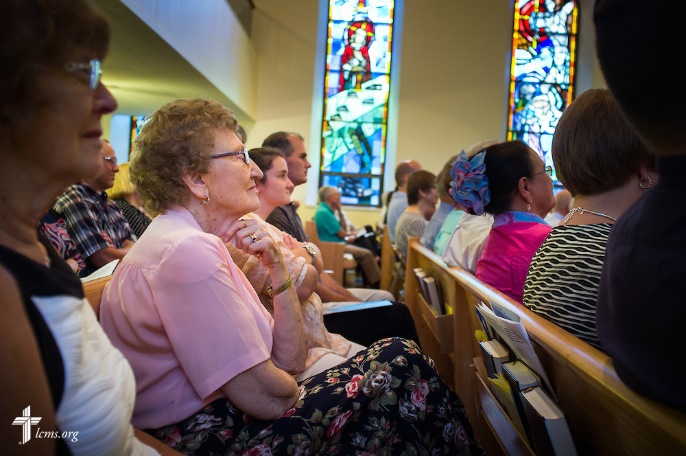 "Parishioner Eunice Hausler listens to a sermon by the Rev. Dr. Matthew C. Harrison, president of The Lutheran Church–Missouri Synod, on Sunday, August 9, 2015, during a ""Day of Thanksgiving and Rededication""  at St. John's Lutheran Church in New Minden, Ill. Nearly two years ago, a tornado damaged the church and surrounding homes, including Hausler's. LCMS Communications/Erik M. Lunsford"