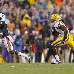 Sep 21, 2013; Baton Rouge, LA, USA; Auburn Tigers quarterback Nick Marshall (14) is pursued by LSU Tigers linebacker Lamin Barrow (18) during a game at Tiger Stadium. Mandatory Credit: Derick E. Hingle-USA TODAY Sports