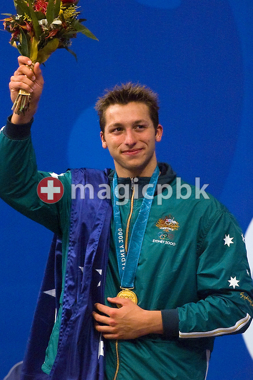 Ian THORPE of Australia celebrates on the podium after he won in a new world record time the men's swimming 400 metre freestyle final held at the National Aquatics Center at the Sydney 2000 Summer Olympic Games in Sydney, Australia, Saturday, Sept. 16, 2000. (Photo by Patrick B. Kraemer / MAGICPBK)