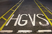 Heavy Goods Vehicle sign stencilled in a lorry park at the DIRFT warehouse logistics park in Daventry.