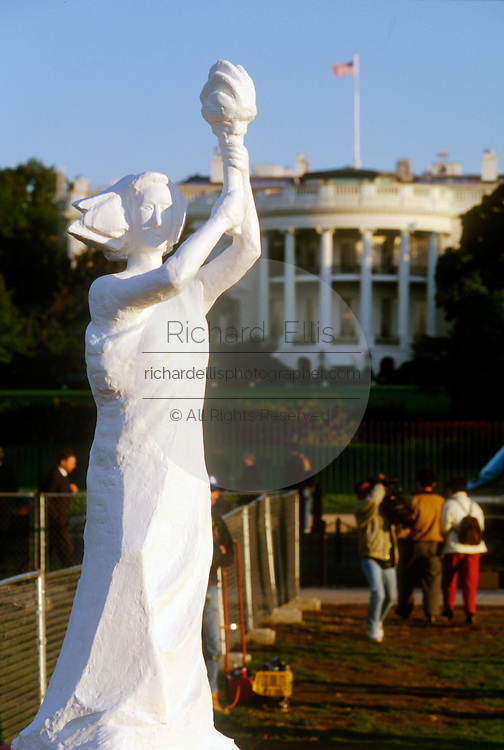 Protestors erect a copy of the Goddess of Democracy statue a symbol of the Tiananmen Square massacre across from the White House October 27, 1997 in Washington, DC.