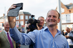 © Licensed to London News Pictures. 10/10/2014. Clacton, UK. Douglas Carswell, newly elected and first ever MP of UKIP for Clacton-on-Sea takes a picture himself with the press pack following him as he visits at Clacton town centre on Friday, 10 October, 2014 after his victory in the by-election of Clacton-on-Sea. Photo credit : Tolga Akmen/LNP