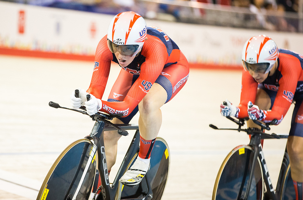 Kelly Catlin of the United States leads her team as they compete in the women's team pursuit qualification on the fist day of track cycling at the 2015 Pan American Games in Toronto, Canada, July 16,  2015.  AFP PHOTO/GEOFF ROBINS