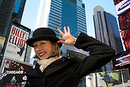 Cabaret dancer promoting the Broadway show in Times Square