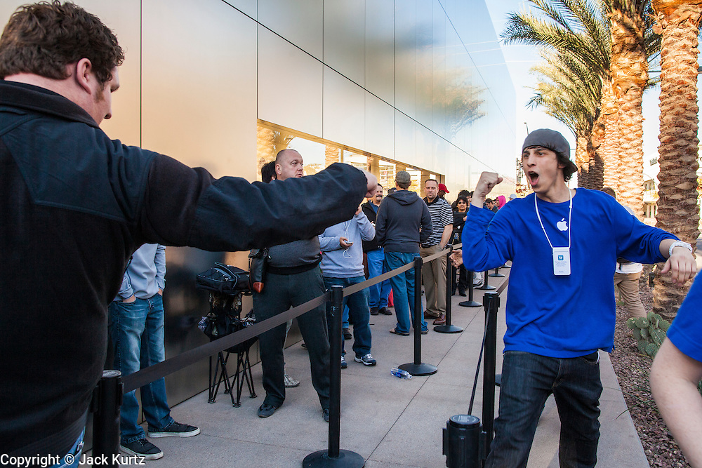 16 MARCH 2012 - SCOTTSDALE, AZ:  Scottsdale Apple Store employees run through the crowd of people waiting to buy the New iPad Friday morning. Several hundred people were in line at the Apple Store in the Scottsdale Quarter in Scottsdale, AZ, Friday to buy the New iPad.  PHOTO BY JACK KURTZ