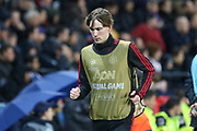 Manchester United midfielder James Garner warms up as a substitute during the Champions League Round of 16 2nd leg match between Paris Saint-Germain and Manchester United at Parc des Princes, Paris, France on 6 March 2019.