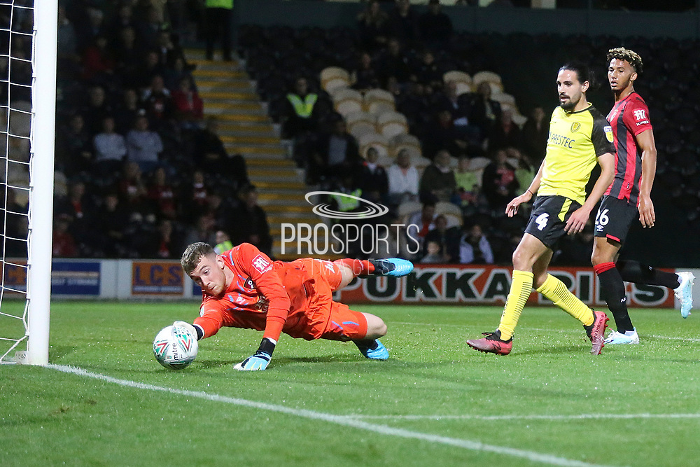 Bournemouth goalkeeper Mark Travers (42) makes a save during the EFL Cup match between Burton Albion and Bournemouth at the Pirelli Stadium, Burton upon Trent, England on 25 September 2019.