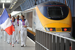© Licensed to London News Pictures. 13/08/2012. London,Britain.French Olympic Team waving their national flag on the platform at St. Pancras International as they leave the UK to head home following the 2012 Olympic games.  Photo credit : Thomas Campean/LNP