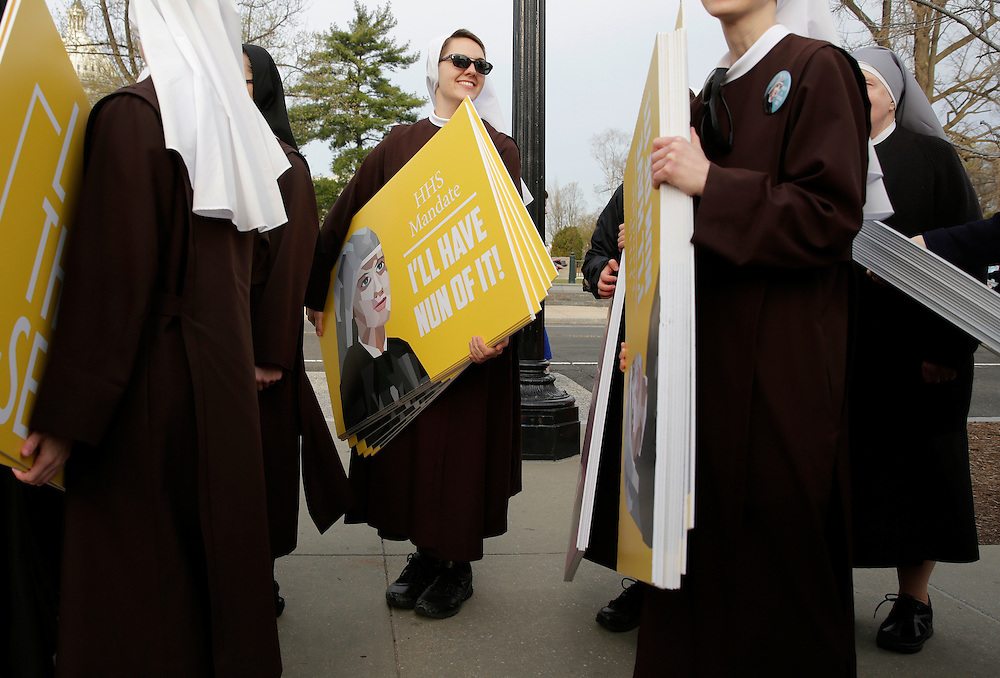Nuns nuns carry placards before Zubik v. Burwell, an appeal brought by Christian groups demanding full exemption from the requirement to provide insurance covering contraception under the Affordable Care Act, is heard by the U.S. Supreme Court in Washington March 23, 2016.      REUTERS/Joshua Roberts