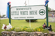 Sign in the historic downtown where Franklin Delano Roosevelt kept his vacation home known as the Little White House in Warm Springs, Georgia.
