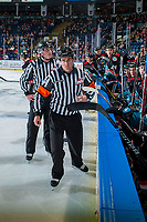 KELOWNA, CANADA - OCTOBER 20: Referee Jeff Ingram skates past the Kelowna Rockets' bench against the Portland Winterhawks on October 20, 2017 at Prospera Place in Kelowna, British Columbia, Canada.  (Photo by Marissa Baecker/Shoot the Breeze)  *** Local Caption ***