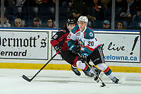 KELOWNA, CANADA - JANUARY 26: Owen Hardy #15 of the Vancouver Giants back checks Conner Bruggen-Cate #20 of the Kelowna Rockets during first period on January 26, 2019 at Prospera Place in Kelowna, British Columbia, Canada.  (Photo by Marissa Baecker/Shoot the Breeze)