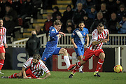 Luke Wilkinson (Stevenage) and Luke James (Hartlepool United) in a race to the ball during the Sky Bet League 2 match between Hartlepool United and Stevenage at Victoria Park, Hartlepool, England on 9 February 2016. Photo by Mark P Doherty.