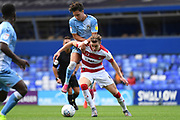 Coventry City midfielder (on loan from Aston Villa) Callum O'Hare (17) fouls Doncaster Rovers midfielder (on loan from Arsenal) Ben Sheaf (6) during the EFL Sky Bet League 1 match between Coventry City and Doncaster Rovers at the Trillion Trophy Stadium, Birmingham, England on 28 September 2019.