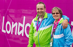 Francek Gorazd Tirsek and coach Polonca Sladic of Slovenia celebrate after Tirsek won second place during the Men's R4-10m Air Rifle Standing shooting Final during Day 5 of the Summer Paralympic Games London 2012 on September 2, 2012, in Royal Artillery Barracks, London, Great Britain. (Photo by Vid Ponikvar / Sportida.com)