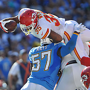 Nov 22, 2015; San Diego, CA, USA; Kansas City Chiefs running back Charcandrick West (35) is stopped short of the goal line by San Diego Chargers LB Joe Mays (57) during the first half of the game at Qualcomm Stadium. Mandatory Credit: Orlando Ramirez-USA TODAY Sports