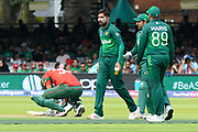 Mohammad Mahmudullah Riyad of Bangladesh goes down after being struck in a sensitive area by a ball bowled by Mohammad Amir of Pakistan during the ICC Cricket World Cup 2019 match between Pakistan and Bangladesh at Lord's Cricket Ground, St John's Wood, United Kingdom on 5 July 2019.