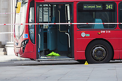 © Licensed to London News Pictures. 24/07/2016. LONDON, UK.  Personal effects and blood at the bus door. A 26 year old man was stabbed outside Bank Tube station in Threadneedle Street near the Bank of England in the early hours of this morning. The man is then reported to have staggered onto the N242 bus, horrifying passengers. Ambulance and police emergency services were then called.  Photo credit: Vickie Flores/LNP