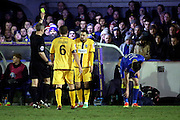 Sutton United defender Dan Spence (17) yellow card during the The FA Cup third round replay match between AFC Wimbledon and Sutton United at the Cherry Red Records Stadium, Kingston, England on 17 January 2017. Photo by Matthew Redman.