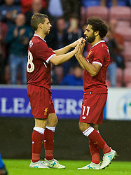 WIGAN, ENGLAND - Friday, July 14, 2017: Liverpool's Mohamed Salah celebrates scoring the first goal against Wigan Athletic during a preseason friendly match at the DW Stadium. (Pic by David Rawcliffe/Propaganda)
