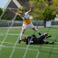 2nd year forward Kirsten Finley (2) of the Regina Cougars collides with goalkeeper Kayla Klim (1) of the Fraser Valley Cascades during the Women's Soccer Homeopener on September 10 at U of R Field. Credit: Arthur Ward/Arthur Images
