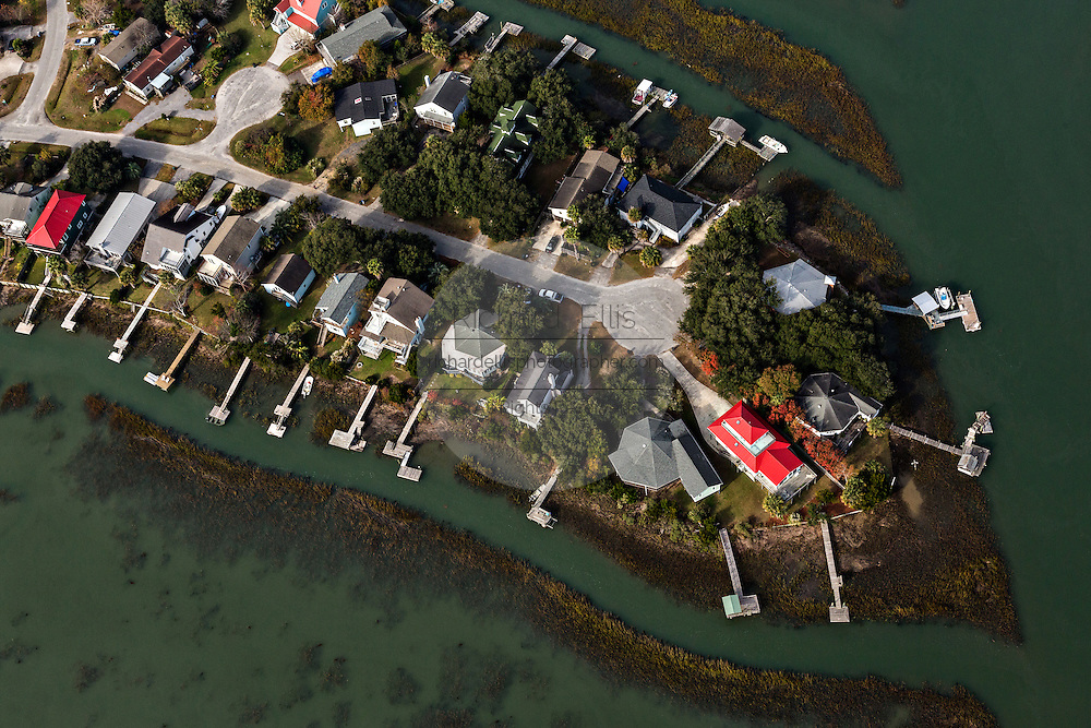 Aerial view of waterfront homes and docks along the marsh in Charleston, SC.