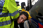 01/02/2009 A man is arrested by a police officer as protesters at the Chinese Embassy attempt to attack the Chinese Premier Wen Jai Boa, as his car arrives there as part of a visit to London