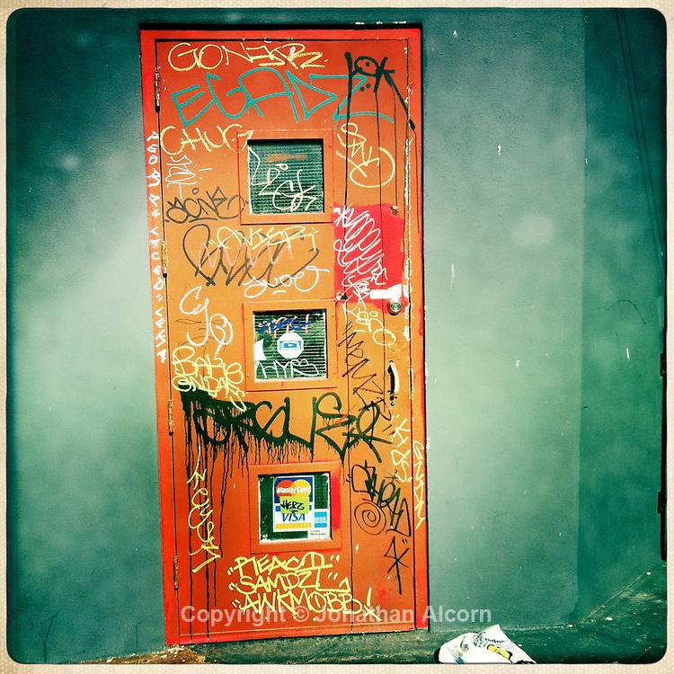 A grafitti filled door in Venice