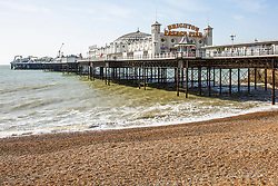 © Licensed to London News Pictures. 21/03/2020. Brighton, UK. Only a handful of people can be seen on the beach in Brighton and Hove as the government asks people to stay home and self isolate to prevent the spread of the Coronavirus. Photo credit: Hugo Michiels/LNP