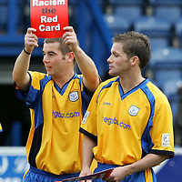 Queen of the South v St Johnstone...16.10.04<br />Peter MacDonald and Jordan Tait with 'Show Racism the Red Card' signs before the game<br /><br />Picture by Graeme Hart.<br />Copyright Perthshire Picture Agency<br />Tel: 01738 623350  Mobile: 07990 594431