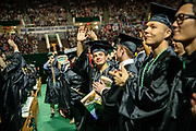 Trent Comfort (Center) waves to supporters art undergraduate commencement. Photo by Ben Siegel
