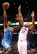 Nov. 23, 2012; Phoenix, AZ, USA; New Orleans Hornets forward Al-Farouq Aminu (0) puts up the ball during the game against the Phoenix Suns forward P.J. Tucker (17) in the first half at US Airways Center. Mandatory Credit: Jennifer Stewart-US PRESSWIRE.