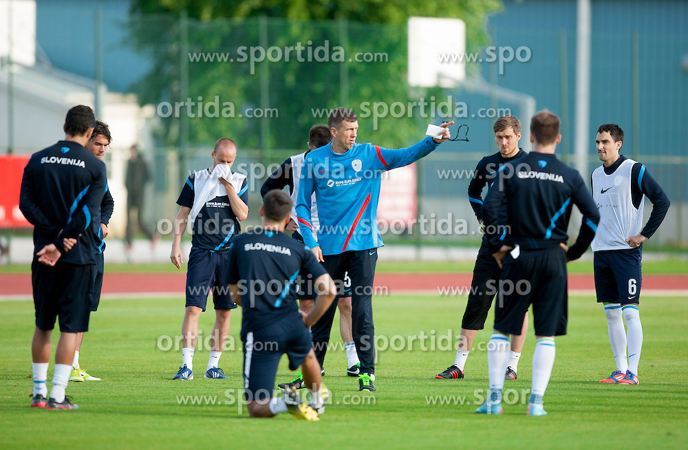Srecko Katanec, head coach talks to players  during practice session of Slovenian National football team at training camp on May 28, 2013 in Sports park Kranj, Slovenia. (Photo By Vid Ponikvar / Sportida)