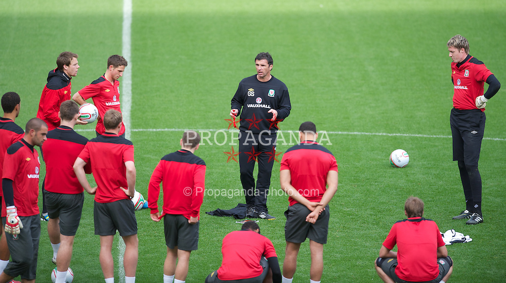 SWANSEA, WALES - Thursday, October 6, 2011: Wales' manager Gary Speed MBE gives a team-talk during a training session ahead of the UEFA Euro 2012 Qualifying Group G match against Switzerland at the  Liberty Stadium. (Pic by David Rawcliffe/Propaganda)