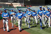 ANAHEIM, CA - APRIL 07:  The Kansas City Royals warm up before the game against the Los Angeles Angels of Anaheim on Saturday, April 7, 2012 at Angel Stadium in Anaheim, California. The Royals won the game 6-3. (Photo by Paul Spinelli/MLB Photos via Getty Images)