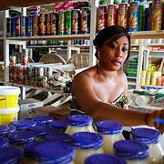 Rushama Venus Mcgill, a graduate of the 10,000 Women Program, inventories her minimart. Monrovia, Liberia, April 2012.