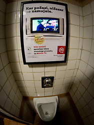 Urinal with TV that broadcasts football in Ljubljana during the 2010 FIFA World Cup South Africa Group C Third Round match between Slovenia and England on June 23, 2010, in Ljubljana, Slovenia. (Photo by Matic Klansek Velej / Sportida) / SPORTIDA PHOTO AGENCY