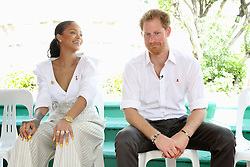 Snger, Rihanna and Prince Harry talk together on stage, at the 'Man Aware' event held by the Barbados National HIV/AIDS Commission in Bridgetown, Barbados, during his tour of the Caribbean.