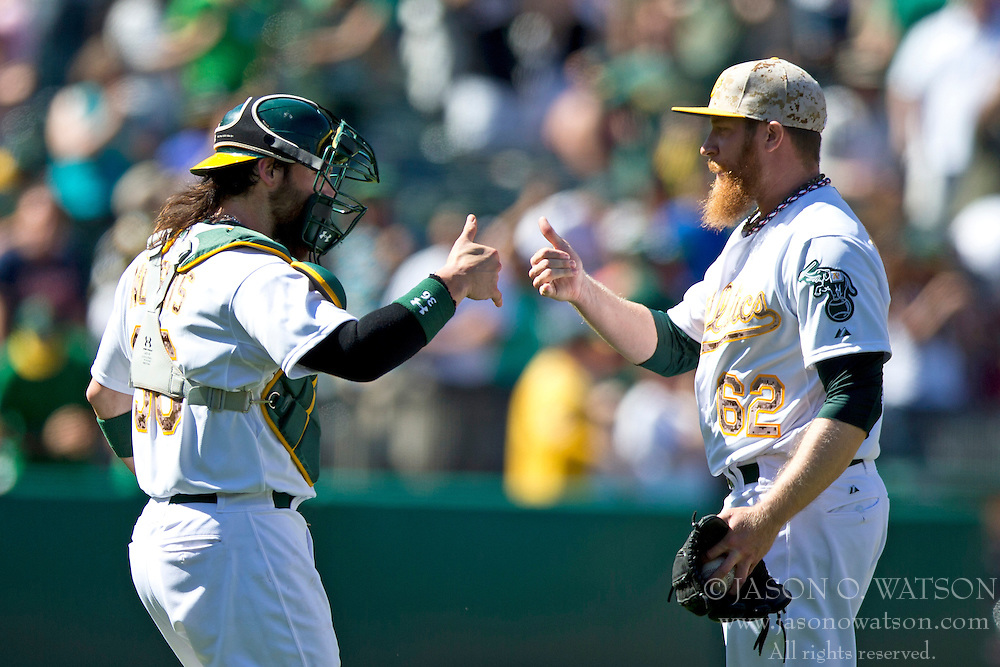 OAKLAND, CA - MAY 26:  Derek Norris #36 of the Oakland Athletics celebrates with Sean Doolittle #62 after the game against the Detroit Tigers at O.co Coliseum on May 26, 2014 in Oakland, California. The Oakland Athletics defeated the Detroit Tigers 10-0.  (Photo by Jason O. Watson/Getty Images) *** Local Caption *** Derek Norris; Sean Doolittle