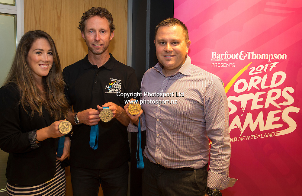 WMG team member Monique Lawry, left,  WMG ambassador and former Olympic gold medalist, Hamish Carter and WMG team member Greg Warnecke with the 2017 medal set  at a press conference Held at Sky City in Auckland to update progress  and unveil the medals for the World Masters Games 2017 to be held in Auckland. <br /> <br /> Credit; Peter Meecham/ www.photosport.nz