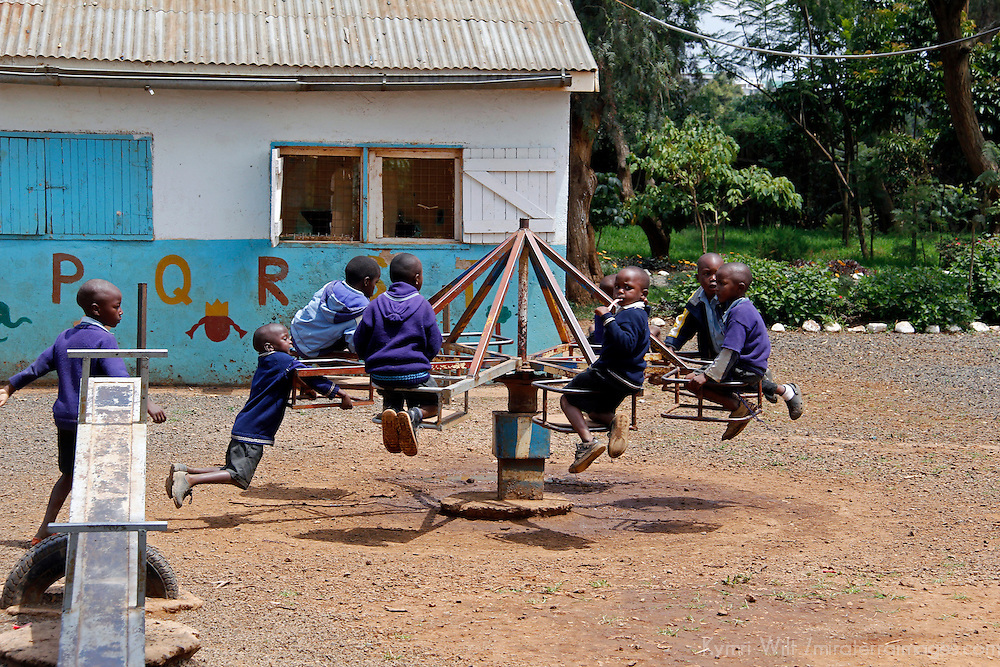 Africa, Kenya, Nanyuki. Children on the playground of the Nanyuki Children's Home.