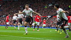16.03.2014, Old Trafford, Manchester, ENG, Premier League, Manchester United vs FC Liverpool, 30. Runde, im Bild Liverpool's captain Steven Gerrard celebrates scoring the second goal against Manchester United from the penalty spot // during the English Premier League 30th round match between Manchester United and Liverpool FC at Old Trafford in Manchester, Great Britain on 2014/03/16. EXPA Pictures © 2014, PhotoCredit: EXPA/ Propagandaphoto/ David Rawcliffe<br /> <br /> *****ATTENTION - OUT of ENG, GBR*****