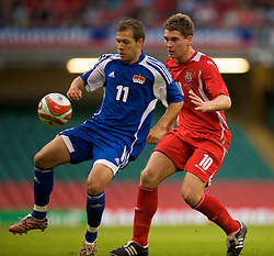 CARDIFF, WALES - Saturday, October 11, 2008: Wales' Sam Vokes and Liechtenstein's Franz Burgmeier during the 2010 FIFA World Cup South Africa Qualifying Group 4 match at the Millennium Stadium. (Photo by David Rawcliffe/Propaganda)