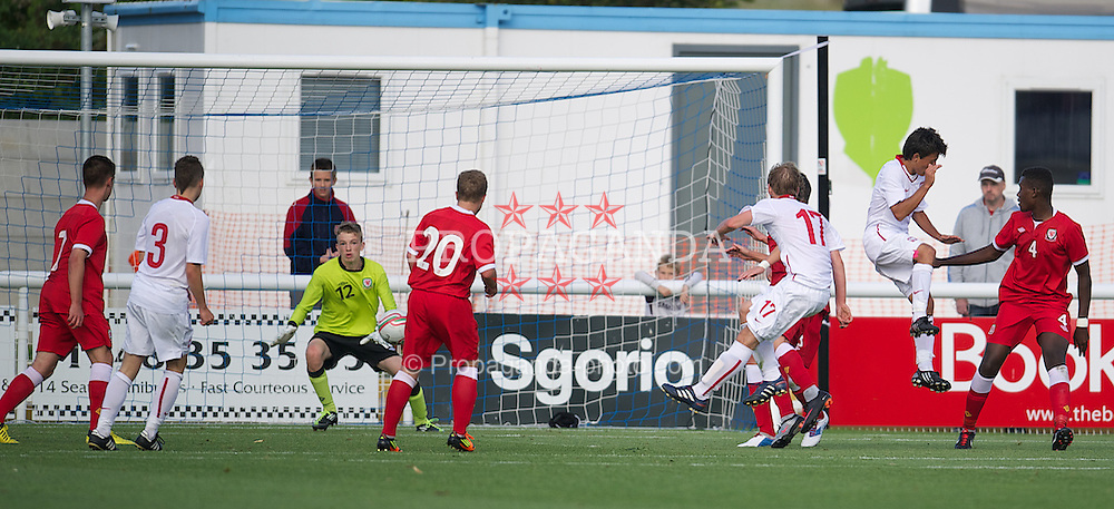 BANGOR, WALES - Thursday, August 30, 2012: Wales' goalkeeper Lewis Thomas is beaten as Poland's Maciej Kwasigroch scores the fourth goal during the International Friendly Under-16's match at the Nantporth Stadium. (Pic by David Rawcliffe/Propaganda)