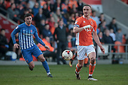 Tom Aldred (Captain) (Blackpool) passes the ball back to his keeper during the EFL Sky Bet League 2 match between Blackpool and Hartlepool United at Bloomfield Road, Blackpool, England on 25 March 2017. Photo by Mark P Doherty.