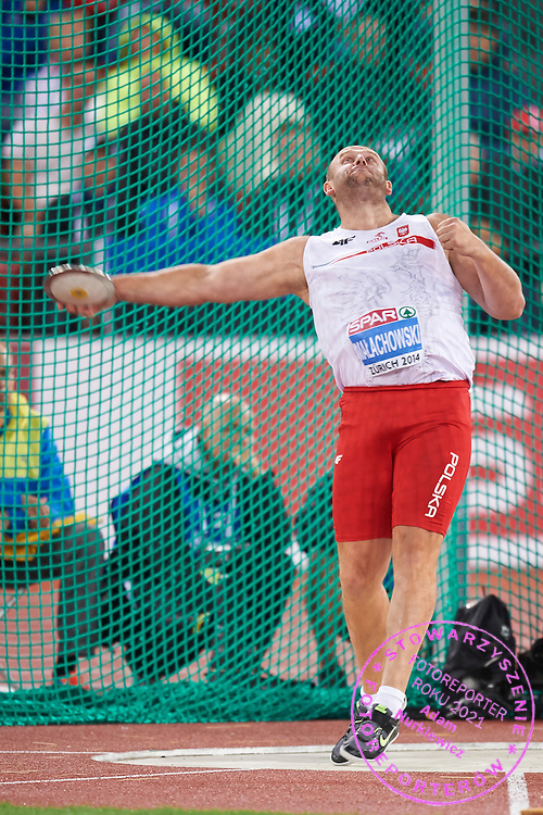 Piotr Malachowski from Poland competes in men's discus throw final during the Second Day of the European Athletics Championships Zurich 2014 at Letzigrund Stadium in Zurich, Switzerland.<br /> <br /> Switzerland, Zurich, August 13, 2014<br /> <br /> Picture also available in RAW (NEF) or TIFF format on special request.<br /> <br /> For editorial use only. Any commercial or promotional use requires permission.<br /> <br /> Photo by &copy; Adam Nurkiewicz / Mediasport