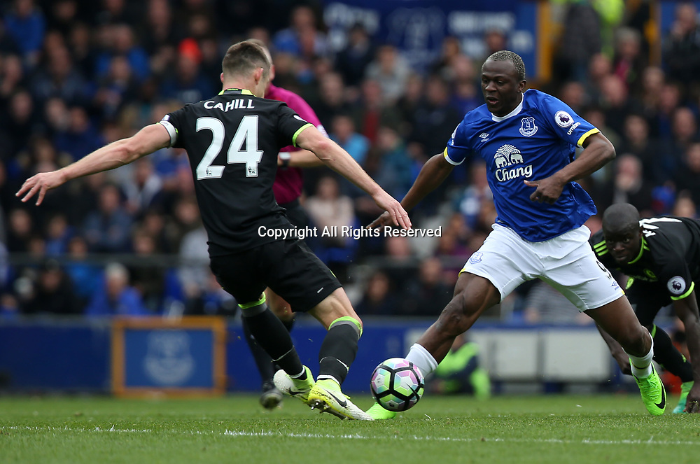 April 30th 2017, Goodison Park, Liverpool, England; EPL Premier league football, Everton versus Chelsea; Arouna Kone of Everton runs with the ball as Gary Cahill of Chelsea attempts to tackle him