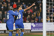 Lyle Taylor of AFC Wimbledon and Bayo Akinfenwa of AFC Wimbledon celebrate in from the Dons fans after his goal during the Sky Bet League 2 match between Cambridge United and AFC Wimbledon at the R Costings Abbey Stadium, Cambridge, England on 2 January 2016. Photo by Stuart Butcher.